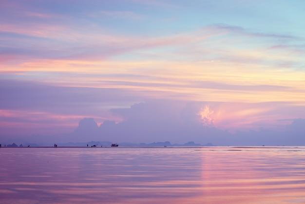 Beautiful beach sunset with big rain clouds and golden light sky Premium Photo