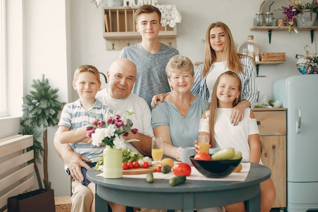 Beautiful big family prepare food in a kitchen Free Photo