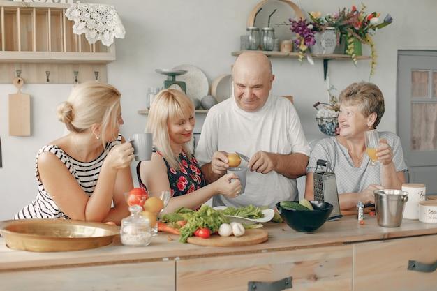 Beautiful big family prepare food in a kitchen Free Photo
