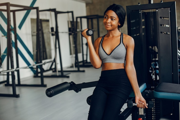 A beautiful black girl is engaged in a gym Free Photo