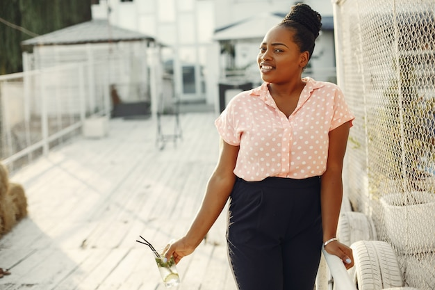 Beautiful black girl standing in a summer park Free Photo
