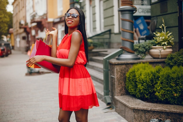 Beautiful black girl with shopping bags in a city Free Photo