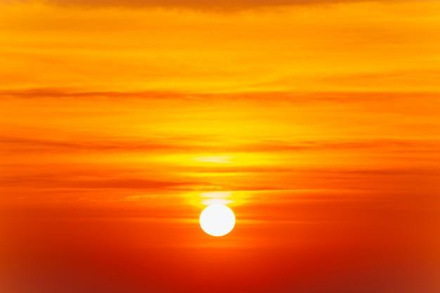 Beautiful blazing sunset landscape and orange sky above it. Premium Photo