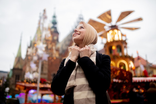 Beautiful blonde at the christmas market in wroclaw, poland Premium Photo
