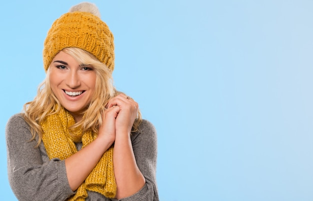 Beautiful blonde in hat and scarf Free Photo