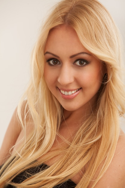 Beautiful blonde woman with long hair Free Photo