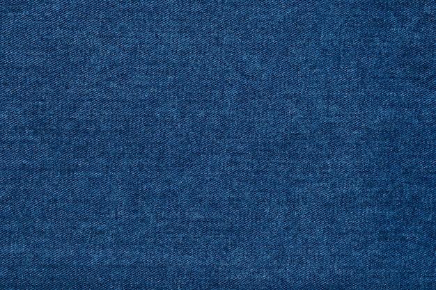 Красивая синяя джинсовая текстура ткани индиго. Premium Фотографии