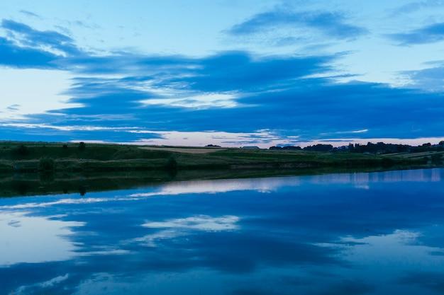 Beautiful blue lake with sky reflection Free Photo