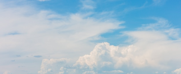 Beautiful blue sky background with white clouds on sunny day Premium Photo