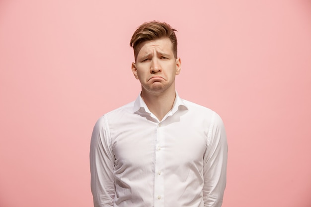 Beautiful bored man isolated on pink wall Free Photo