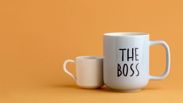 Beautiful boss day concept with cups Free Photo