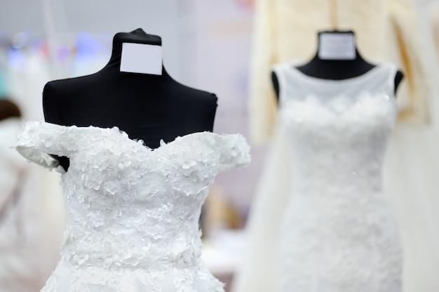 Beautiful bridal dresses on a mannequin. wedding shopping Premium Photo