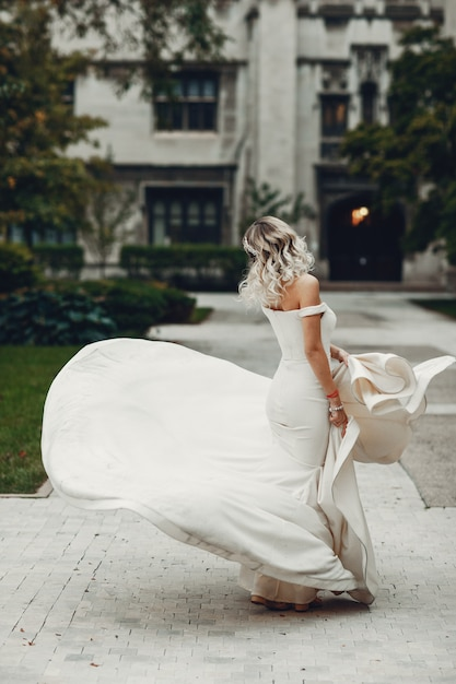 Beautiful bride in a park Free Photo