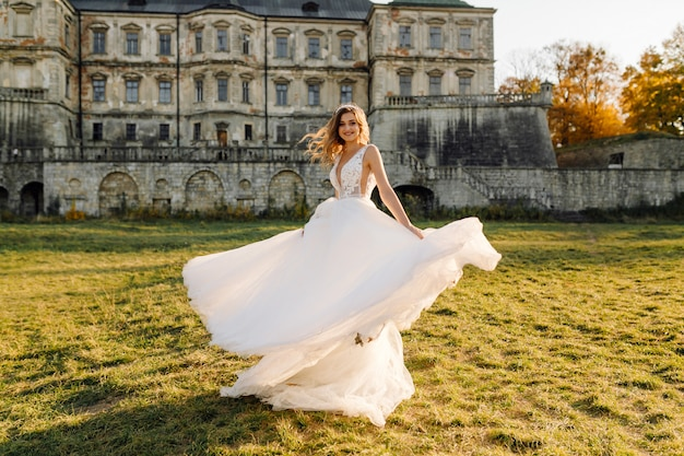 A beautiful bride wearing wedding dress Free Photo