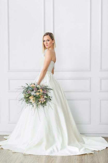 Beautiful bride in a wedding dress Free Photo