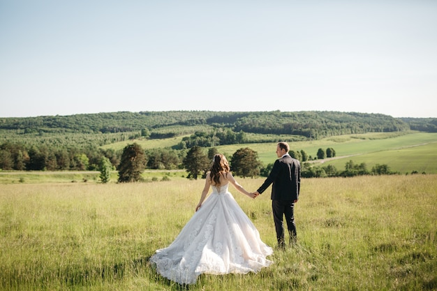 Beautiful brides enjoys nature in the summer Free Photo