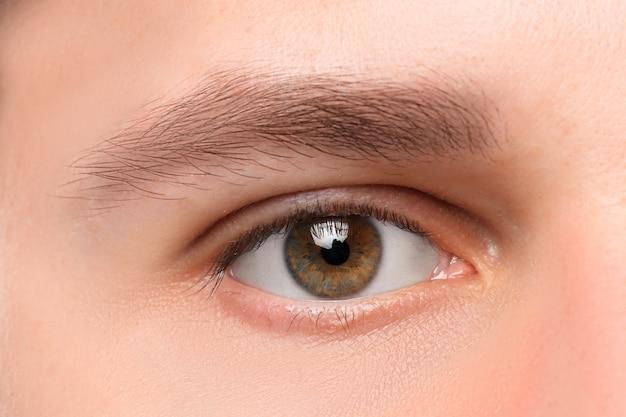 Beautiful brown man eye close up Free Photo