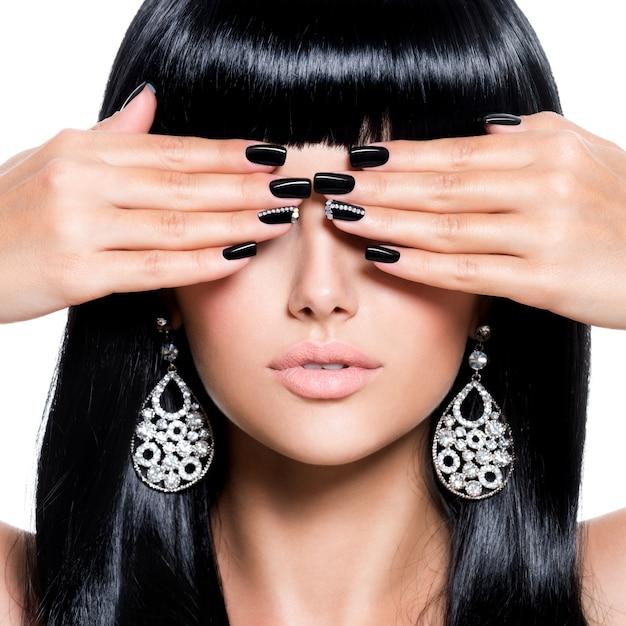 Beautiful brunet woman with black nails Free Photo