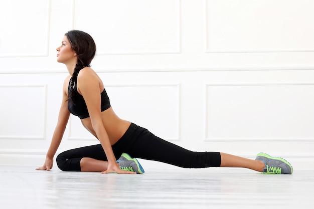 Beautiful brunette doing exercise Free Photo