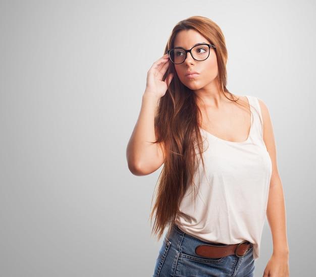 Beautiful brunette in specs. Free Photo