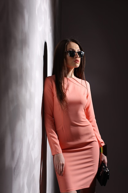 Beautiful brunette woman with sunglasses and long hair posing Premium Photo