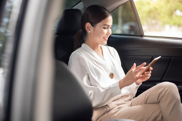 Beautiful business woman is working in car Premium Photo