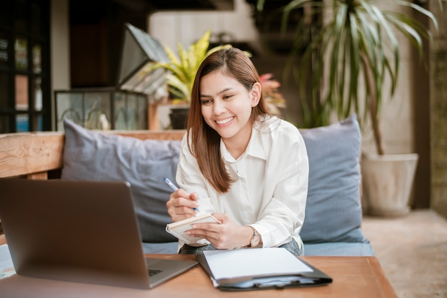 Beautiful business woman is working with her laptop computer in coffee shop Premium Photo