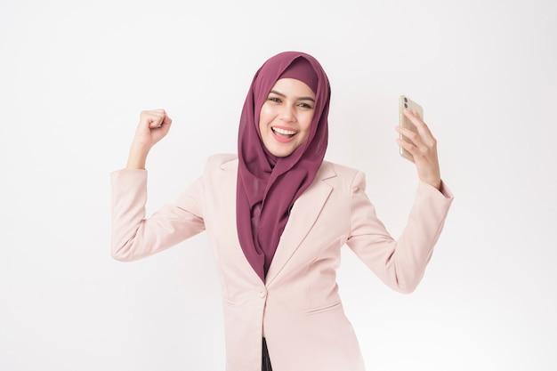 Beautiful business woman with hijab portrait on white wall Premium Photo