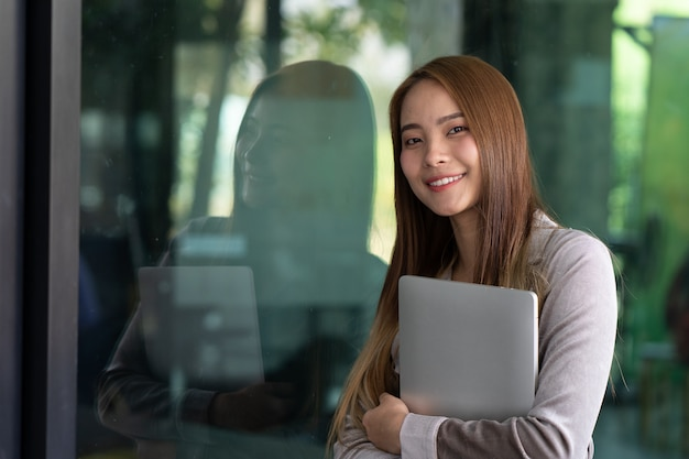 Beautiful business young women are smile in front of her office Premium Photo
