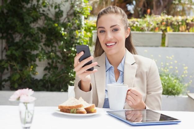 Beautiful businesswoman on her lunch Premium Photo