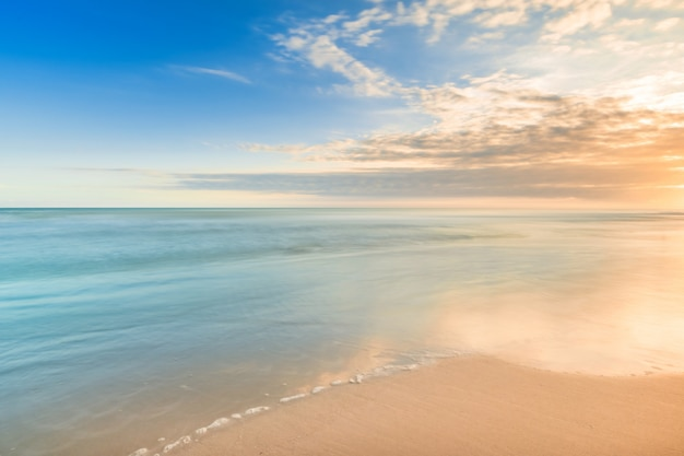 Beautiful calmness sunset on the tropical beach with a little waves look like the paradise in relaxing time Premium Photo