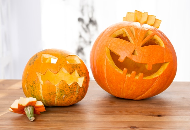 Beautiful carved pumpkins on a table Free Photo