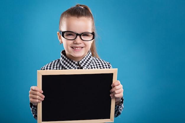 Beautiful caucasian brunette child hold empty poster Premium Photo