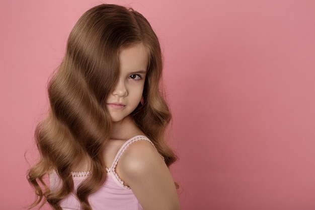 Beautiful caucasian girl with bright red hair. curly hair of red color Premium Photo