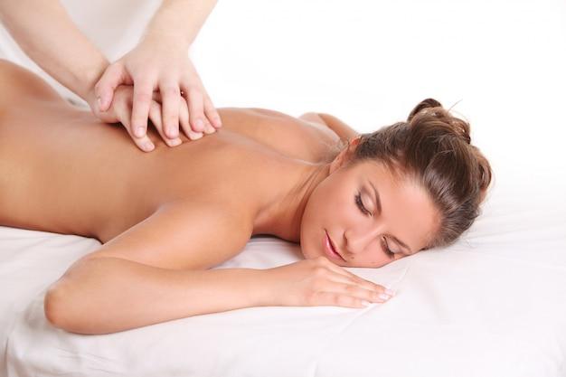 Beautiful caucasian woman enjoy massage Free Photo