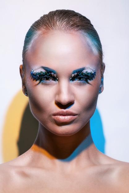 Beautiful caucasian woman with artistic makeup Free Photo