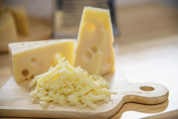 Beautiful cheeses in the kitchen - cheese food preparing concept Free Photo