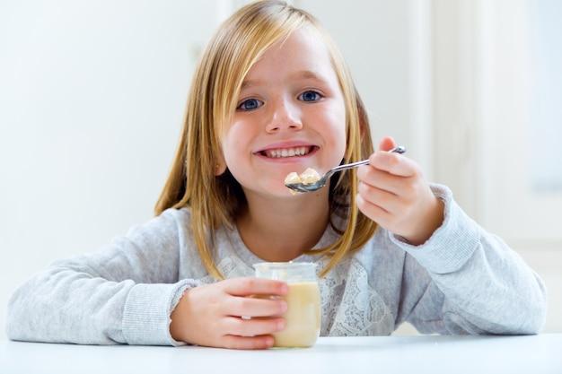 Beautiful child having breakfast at home. Free Photo