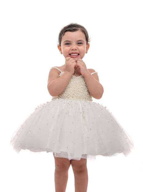 Beautiful child in white wedding dress Premium Photo