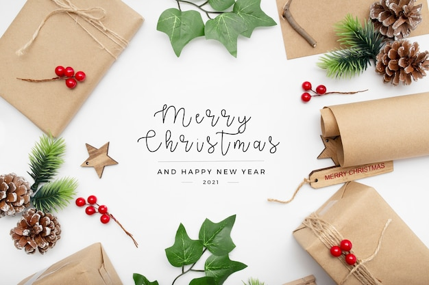 Beautiful christmas gifts and elements on desk Free Photo
