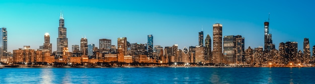 Beautiful cityscape panorama view of buildings in chicago downtown district at twilight blue hour, banner size Premium Photo