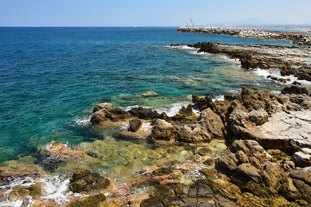 Beautiful clean sea and waves. summer background for travel and holidays. greece crete.. amazing sce Free Photo