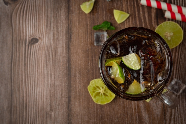 Beautiful cold drink of cola with ice cubes Free Photo