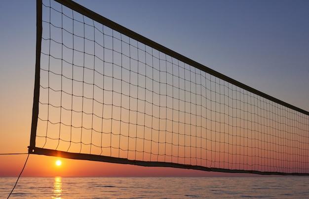 Beautiful colorful sunset over the sea and the sun shines. orange sky. Free Photo