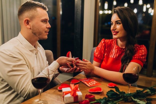 Beautiful couple engaging at dinner Free Photo