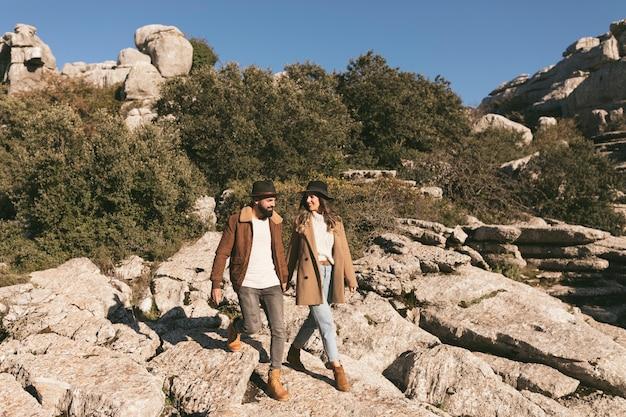 Beautiful couple having a mountain trip Free Photo
