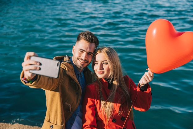 Beautiful Couple Posing For Selfie With Balloon Free Photo