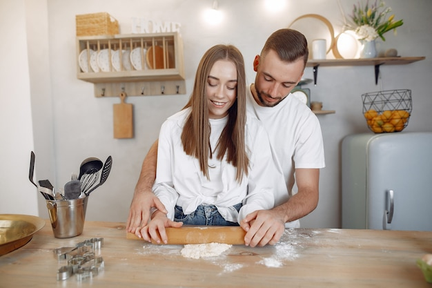 Beautiful couple prepare food in a kitchen Free Photo