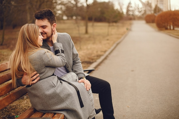 Beautiful couple spend time in a autumn park Free Photo