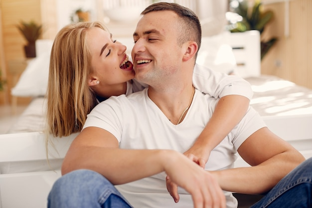 Beautiful couple spend time in the bedroom Free Photo